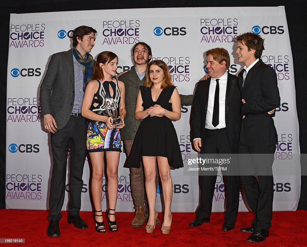 Actors Nicholas Braun, Emma Watson, Ezra Miller, Mae Whitman and Johnny Simmons, with writer-director Stephen Chbosky (2nd R), winners of Favorite Drama Movie for 'The Perks of Being a Wallflower,' pose in the press room at the 39th Annual People's Choice Awards at Nokia Theatre L.A. Live on January 9, 2013 in Los Angeles, California.