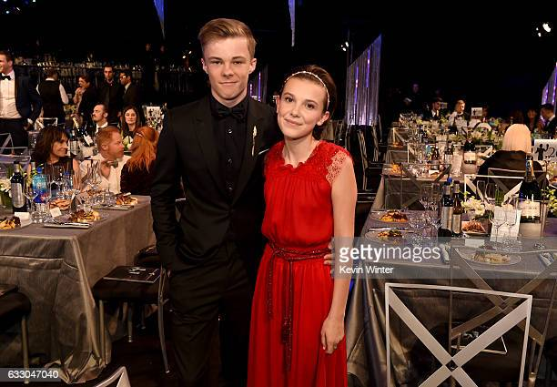 Actors Nicholas Hamilton and Millie Bobby Brown attend The 23rd Annual Screen Actors Guild Awards Cocktail Reception at The Shrine Auditorium on...