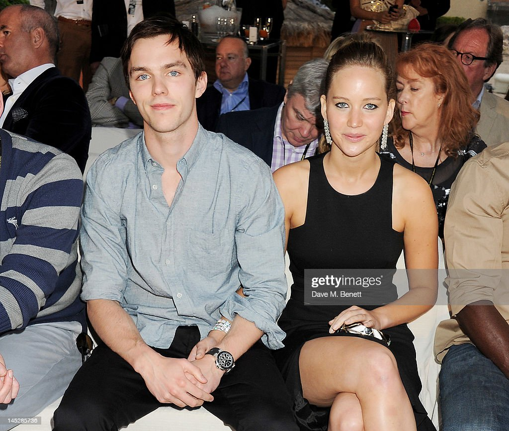 Actors <a gi-track='captionPersonalityLinkClicked' href=/galleries/search?phrase=Nicholas+Hoult&family=editorial&specificpeople=598892 ng-click='$event.stopPropagation()'>Nicholas Hoult</a> (L) and <a gi-track='captionPersonalityLinkClicked' href=/galleries/search?phrase=Jennifer+Lawrence&family=editorial&specificpeople=1596040 ng-click='$event.stopPropagation()'>Jennifer Lawrence</a> attend a cocktail reception during Amber Lounge Fashion Monaco 2012 at Le Meridien Beach Plaza Hotel on May 25, 2012 in Monaco, Monaco