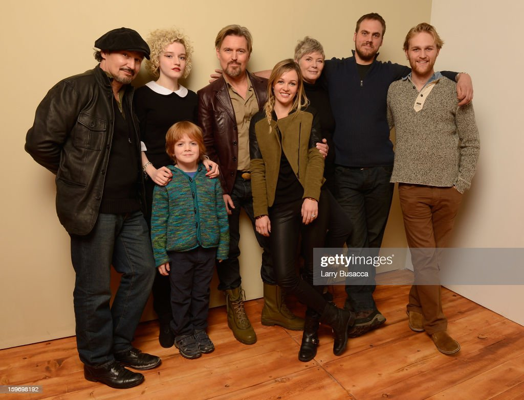 Actors Nick Damici, Jack Gore, Julia Garner, Bill Sage, Ambyr Childers, Kelly McGillis, writer/director Jim Mickle and actor Wyatt Russell pose for a portrait during the 2013 Sundance Film Festival at the Getty Images Portrait Studio at Village at the Lift on January 18, 2013 in Park City, Utah.