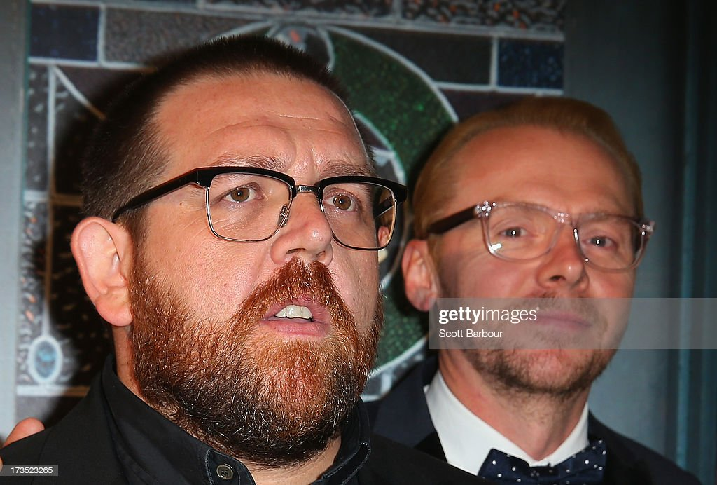 Actors Nick Frost and <a gi-track='captionPersonalityLinkClicked' href=/galleries/search?phrase=Simon+Pegg&family=editorial&specificpeople=206280 ng-click='$event.stopPropagation()'>Simon Pegg</a> arrive for 'The World's End' Australian premiere at Hoyts Melbourne Central on July 16, 2013 in Melbourne, Australia.