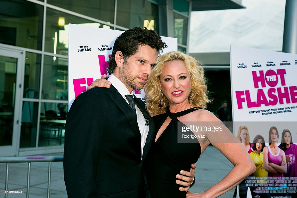 Actors Nick Holmes (L) and <a gi-track='captionPersonalityLinkClicked' href=/galleries/search?phrase=Virginia+Madsen&family=editorial&specificpeople=202232 ng-click='$event.stopPropagation()'>Virginia Madsen</a> arrive at 'The Hot Flashes' Los Angeles premiere at ArcLight Cinemas on June 27, 2013 in Hollywood, California.