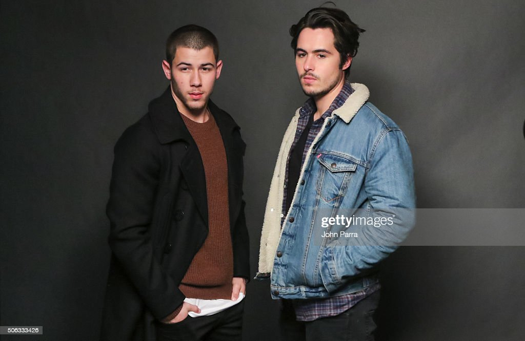 Actors Nick Jonas (L) and Ben Schnetzer from the film 'Goat' pose for a portrait during The Hollywood Reporter 2016 Sundance Studio at Rock & Reilly's Day 1 on January 22, 2016 in Park City, Utah.