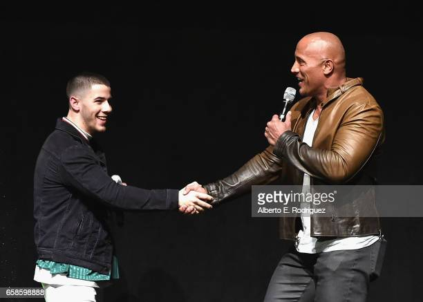 Actors Nick Jonas and Dwayne Johnson speak onstage during the CinemaCon 2017 Gala Opening Night Event Sony Pictures Highlights its 2017 Summer and...