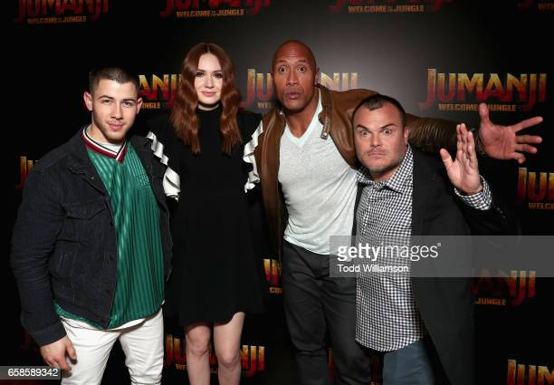 Actors Nick Jonas Karen Gillan Dwayne Johnson and Jack Black during a photo call for Columbia Pictures' JUMANJI WELCOME TO THE JUNGLE at Caesars...