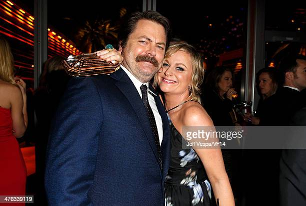 Actors Nick Offerman and Amy Poehler attend the 2014 Vanity Fair Oscar Party Hosted By Graydon Carter on March 2 2014 in West Hollywood California
