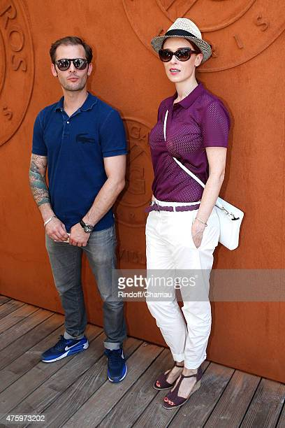 Actors Nicolas Duvauchelle and Audrey Fleurot attend the 2015 Roland Garros French Tennis Open Day Thirteen on June 5 2015 in Paris France