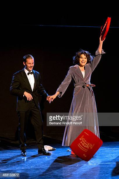 Actors Nicolas Duvauchelle and Fanny Ardant during the traditional throw of cushions at the final greeting of 'Des journees entieres dans les arbres'...