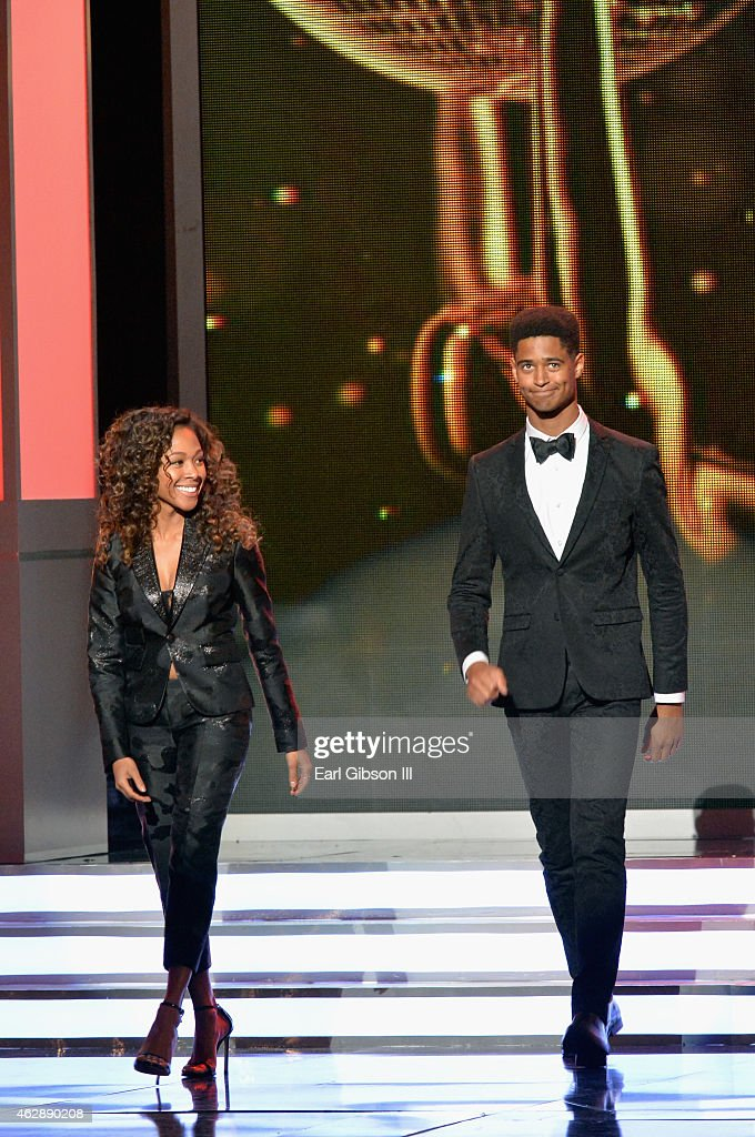 Actors Nicole Beharie (L) and Alfred Enoch speak onstage at the 46th Annual NAACP Image Awards on February 6, 2015 in Pasadena, California.