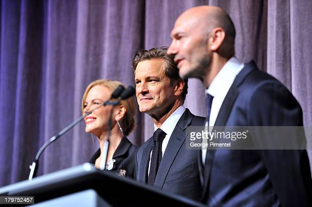 Actors Nicole Kidman and Colin Firth and director Jonathan Teplitzky arrive at 'The Railway Man' premiere during the 2013 Toronto International Film...