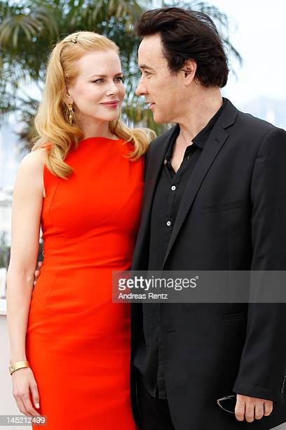 Actors Nicole Kidman and John Cusack attend the 'The Paperboy' photocall during the 65th Annual Cannes Film Festival at Palais des Festivals on May...