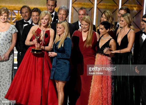 Actors Nicole Kidman and Reese Witherspoon with cast and crew of 'Big Little Lies' accept the Outstanding Limited Series award onstage during the...