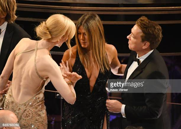 Actors Nicole Kidman Jennifer Aniston and Justin Theroux speak during the 89th Annual Academy Awards at Hollywood Highland Center on February 26 2017...