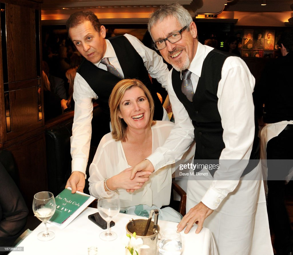 Actors Nigel Lindsay (L) and <a gi-track='captionPersonalityLinkClicked' href=/galleries/search?phrase=Griff+Rhys+Jones&family=editorial&specificpeople=226712 ng-click='$event.stopPropagation()'>Griff Rhys Jones</a> (R), working as waiters, attend One Night Only at The Ivy, featuring 30 stage and screen actors working as staff during dinner at The Ivy, in aid of The Combined Theatrical Charities, on December 2, 2012 in London, England.