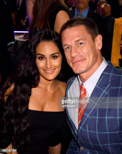 Actors Nikki Bella and John Cena attend the 2017 MTV Movie And TV Awards at The Shrine Auditorium on May 7 2017 in Los Angeles California