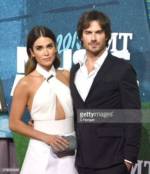 Actors Nikki Reed and Ian Somerhalder attend the 2015 CMT Music awards at the Bridgestone Arena on June 10 2015 in Nashville Tennessee