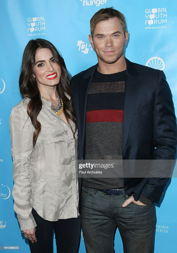Actors Nikki Reed (L) and Kellan Lutz (R) attend the 'mPowering Action' platform launch at The Conga Room at L.A. Live on February 8, 2013 in Los Angeles, California.