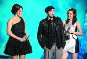Actors Nikki Reed Jackson Rathbone and Kristen Stewart accept an award onstage during Spike TV's 'Scream 2010' at The Greek Theatre on October 16...