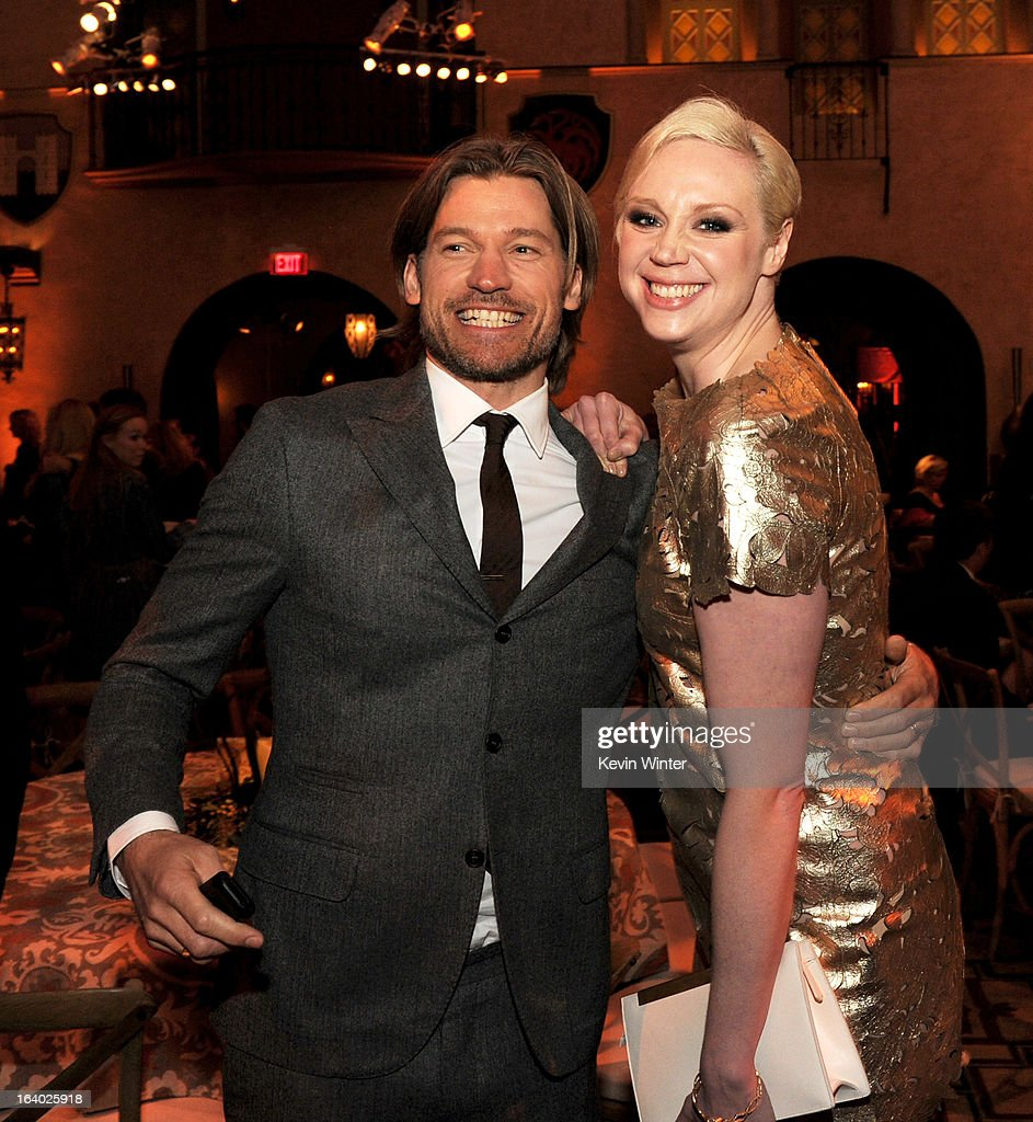 Actors Nikolaj Coster-Waldau (L) and <a gi-track='captionPersonalityLinkClicked' href=/galleries/search?phrase=Gwendoline+Christie&family=editorial&specificpeople=6341361 ng-click='$event.stopPropagation()'>Gwendoline Christie</a> pose at the after party for the premiere of HBO's 'Game Of Thrones' at the Roosevelt Hotel on March 18, 2013 in Los Angeles, California.