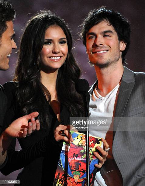 Actors Nina Dobrev and Ian Somerhalder speak onstage during Spike TV's 'Scream 2010' at The Greek Theatre on October 16 2010 in Los Angeles California
