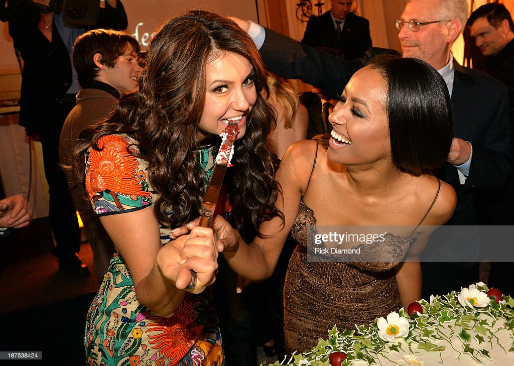 Actors <a gi-track='captionPersonalityLinkClicked' href=/galleries/search?phrase=Nina+Dobrev&family=editorial&specificpeople=4397485 ng-click='$event.stopPropagation()'>Nina Dobrev</a> and Kat Graham attend The Vampire Diaries 100th Episode Celebration on November 9, 2013 in Atlanta, Georgia.