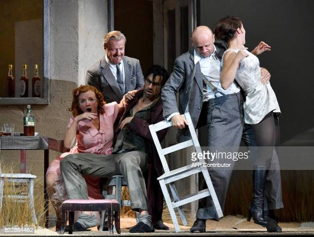 Actors Nina Petri Roland Koch Max Simonischek Oliver Stokowski Andrea Wenzl perform in the rehearsal of Harold Pinter's 'Die Geburtstagsfeier' in...