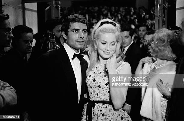 Actors Nino Castelnuovo And Catherine Deneuve After the Presentation Of the Movie 'Les Parapluies de Cherbourg' In Competition At the Cannes Film...