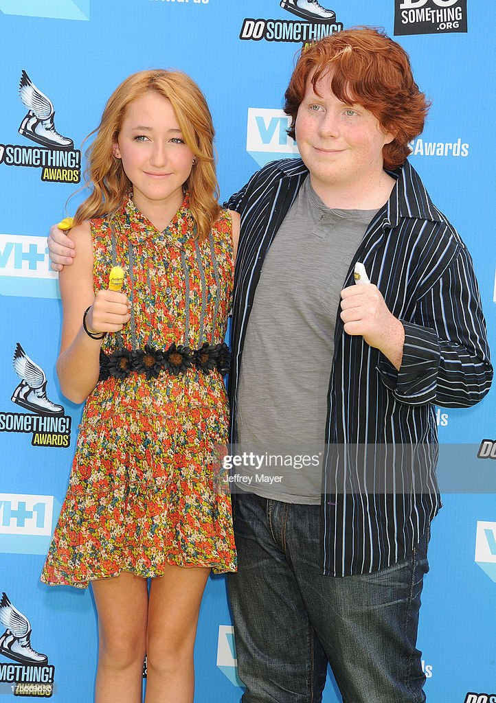 Actors <a gi-track='captionPersonalityLinkClicked' href=/galleries/search?phrase=Noah+Cyrus&family=editorial&specificpeople=5363850 ng-click='$event.stopPropagation()'>Noah Cyrus</a> (L) and <a gi-track='captionPersonalityLinkClicked' href=/galleries/search?phrase=Tucker+Albrizzi&family=editorial&specificpeople=5639448 ng-click='$event.stopPropagation()'>Tucker Albrizzi</a> arrive at the DoSomething.org and VH1's 2013 Do Something Awards at Avalon on July 31, 2013 in Hollywood, California.
