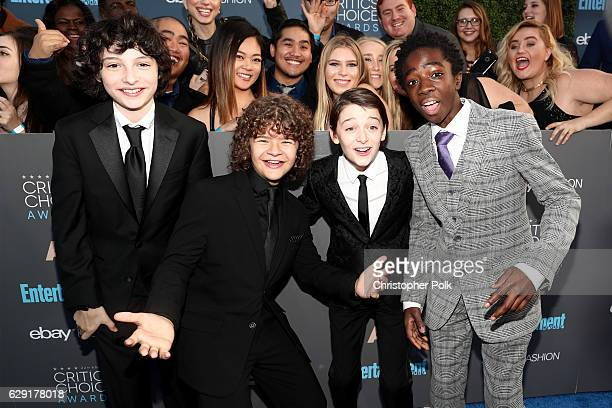 Actors Noah Schnapp Gaten Matarazzo Finn Wolfhard and Caleb McLaughlin attend The 22nd Annual Critics' Choice Awards at Barker Hangar on December 11...