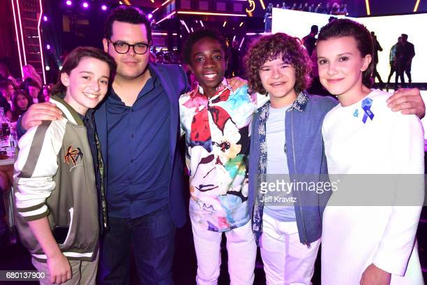 Actors Noah Schnapp Josh Gad Caleb McLaughlin Gaten Matarazzo and Millie Bobby Brown attend the 2017 MTV Movie And TV Awards at The Shrine Auditorium...
