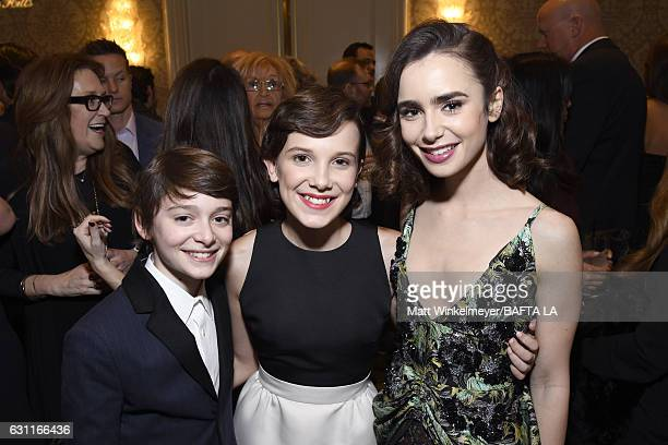 Actors Noah Schnapp Millie Bobby Brown and Lily Collins attend The BAFTA Tea Party at Four Seasons Hotel Los Angeles at Beverly Hills on January 7...