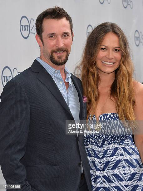 Actors Noah Wyle and Moon Bloodgood arrive to TNT's 25th Anniversary Party at The Beverly Hilton Hotel on July 24 2013 in Beverly Hills California