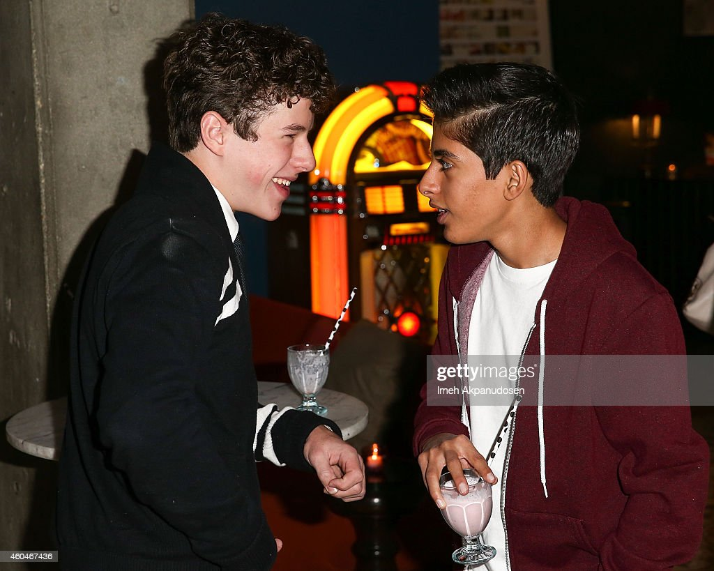 Actors <a gi-track='captionPersonalityLinkClicked' href=/galleries/search?phrase=Nolan+Gould&family=editorial&specificpeople=5691358 ng-click='$event.stopPropagation()'>Nolan Gould</a> (L) and <a gi-track='captionPersonalityLinkClicked' href=/galleries/search?phrase=Karan+Brar&family=editorial&specificpeople=8042083 ng-click='$event.stopPropagation()'>Karan Brar</a> attend G. Hannelius's 16th Birthday Celebration at Palihouse on December 13, 2014 in West Hollywood, California.