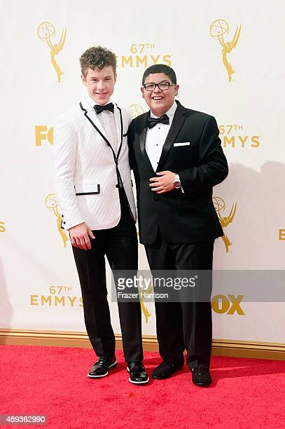 Actors Nolan Gould and Rico Rodriguez attend the 67th Annual Primetime Emmy Awards at Microsoft Theater on September 20 2015 in Los Angeles California