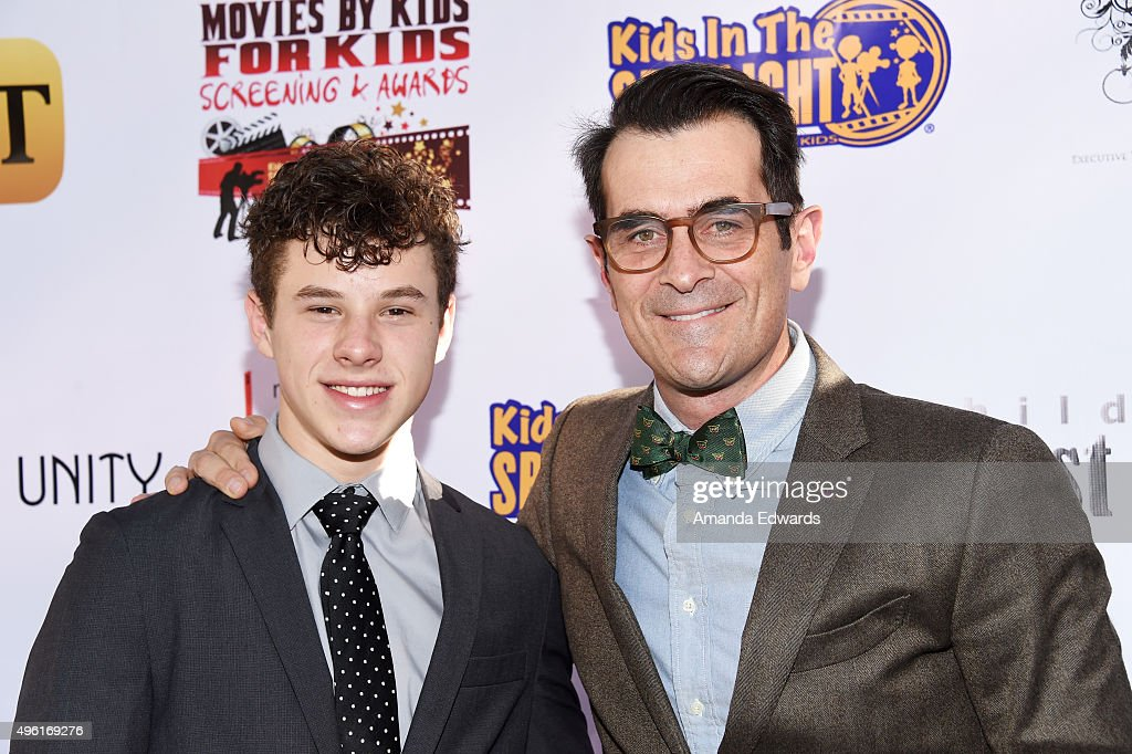 Actors Nolan Gould (L) and Ty Burrell arrive at the Kids In The Spotlight's Movies By Kids, For Kids Film Awards at Fox Studios on November 7, 2015 in Los Angeles, California.