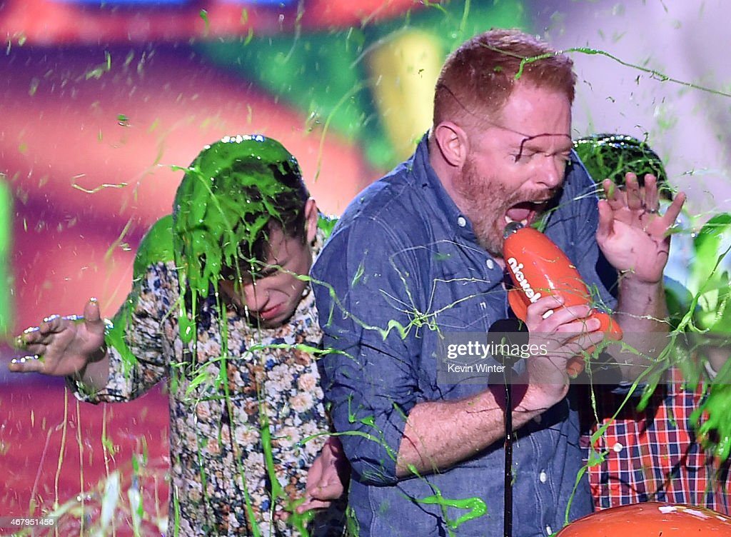 Actors Nolan Gould Jesse Tyler Ferguson and Rico Rodriguez get slimed as they accept award for Favorite Family TV Show for Modern Family onstage...