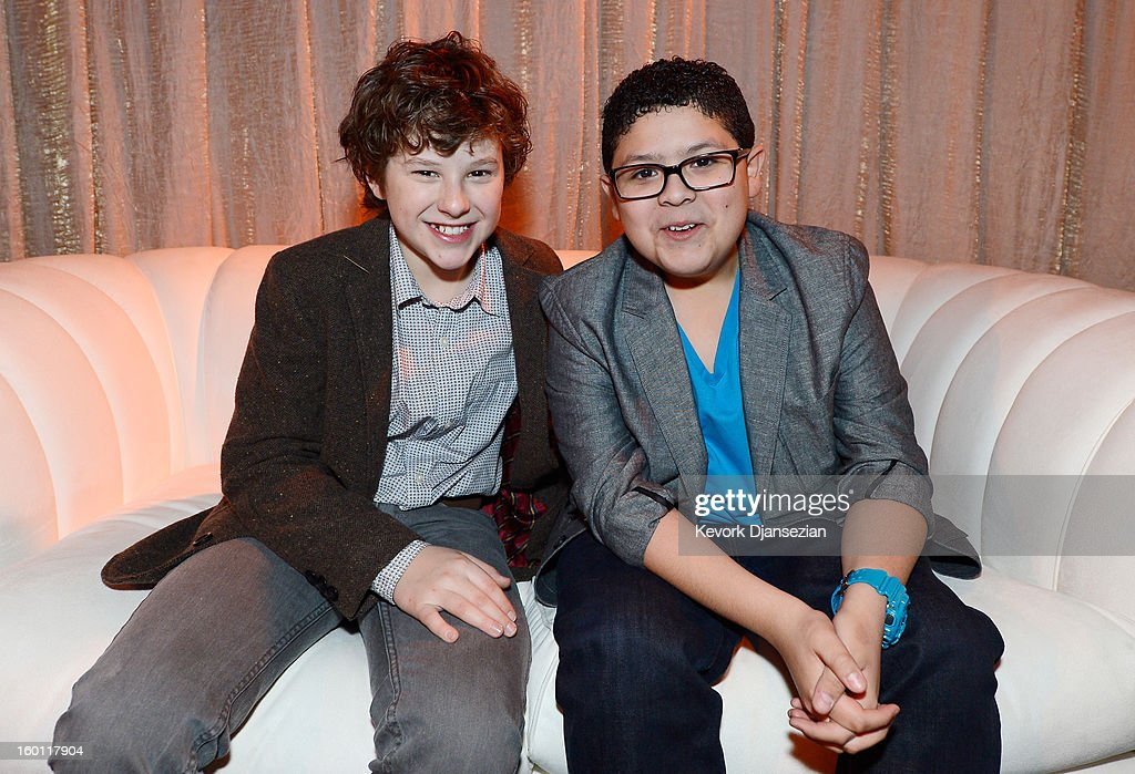 Actors <a gi-track='captionPersonalityLinkClicked' href=/galleries/search?phrase=Nolan+Gould&family=editorial&specificpeople=5691358 ng-click='$event.stopPropagation()'>Nolan Gould</a> (L) Rico Rodriguez in the green room during the 19th Annual Screen Actors Guild Awards red carpet roll out and presenter rehearsals at The Shrine Auditorium on January 26, 2013 in Los Angeles, California.
