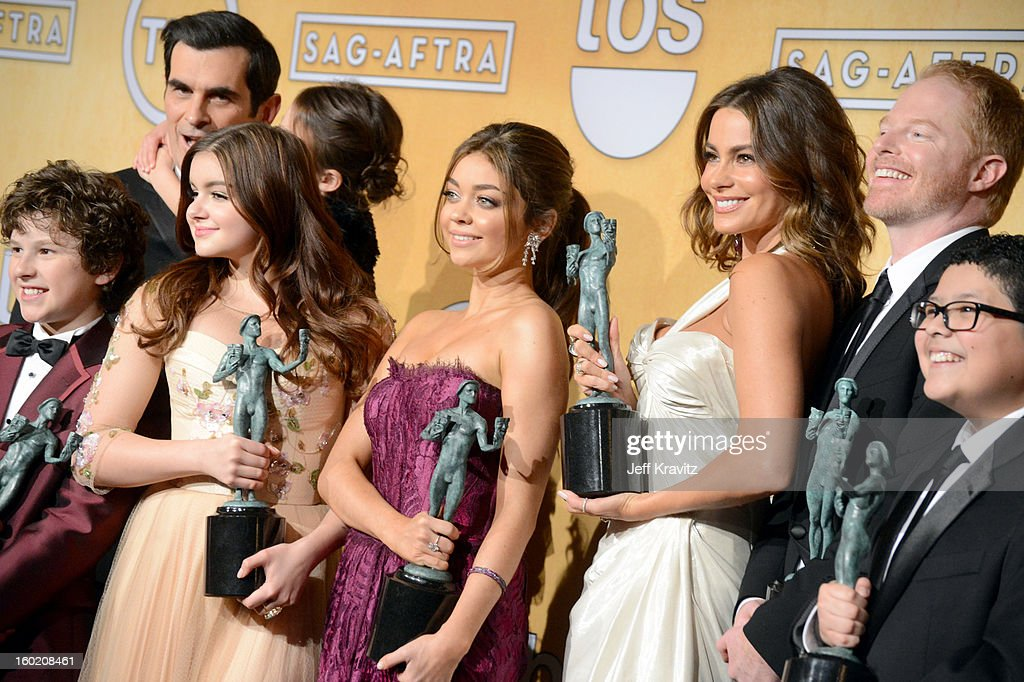 Actors Nolan Gould, Ty Burrell, Aubrey Anderson-Emmons, Ariel Winter, Sarah Hyland, Sofia Vergara, Jesse Tyler Ferguson and Rico Rodriguez pose in the press room during the 19th Annual Screen Actors Guild Awards held at The Shrine Auditorium on January 27, 2013 in Los Angeles, California.