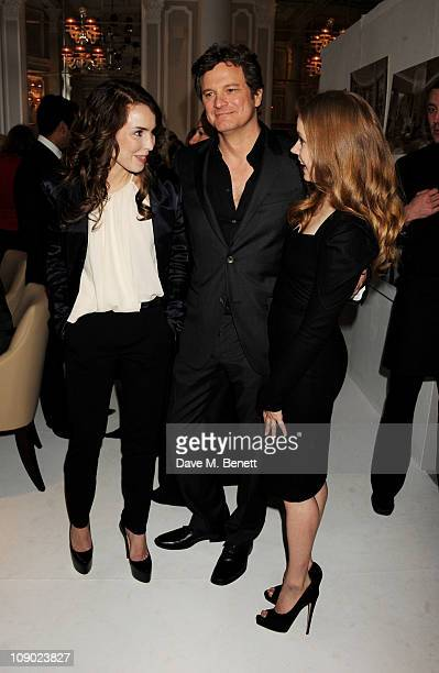 Actors Noomi Rapace Colin Firth and Amy Adams attend Momentum Pictures' preBAFTA lunch at the Corinthia Hotel London on February 12 2011 in London...