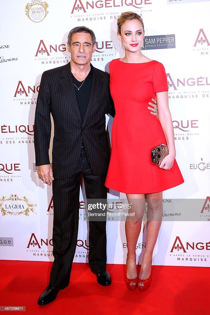 Actors Nora Arnezeder and Gerard Lanvin attend the 'Angelique' Paris movie premiere at Cinema Gaumont Capucine on December 16, 2013 in Paris, France.