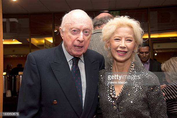 Actors Norman Lloyd and France Nuyen attend The Academy Of Motion Picture Arts And Sciences' Presents The 60th Anniversary Screening Of 'Limelight'...
