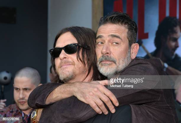 Actors Norman Reedus and Jeffrey Dean Morgan attend AMC's celebration of the 100th episode of 'The Walking Dead' at The Greek Theatre on October 22...
