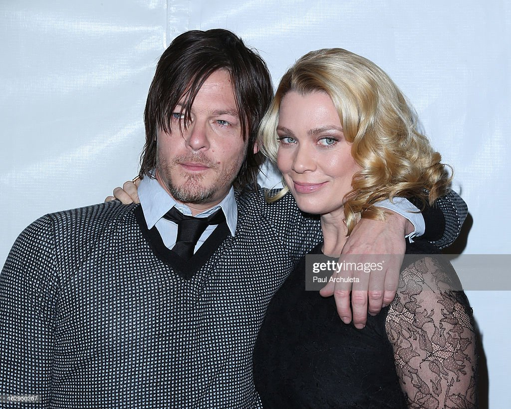 Actors Norman Reedus (L) and Laurie Holden (R) attend the 30th Annual PaleyFest featuring the cast of 'The Walking Dead' at Saban Theatre on March 1, 2013 in Beverly Hills, California.