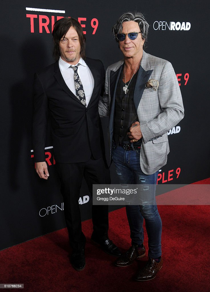 Actors Norman Reedus and Mickey Rourke arrive at the premiere of Open Road's 'Triple 9' at Regal Cinemas L.A. Live on February 16, 2016 in Los Angeles, California.