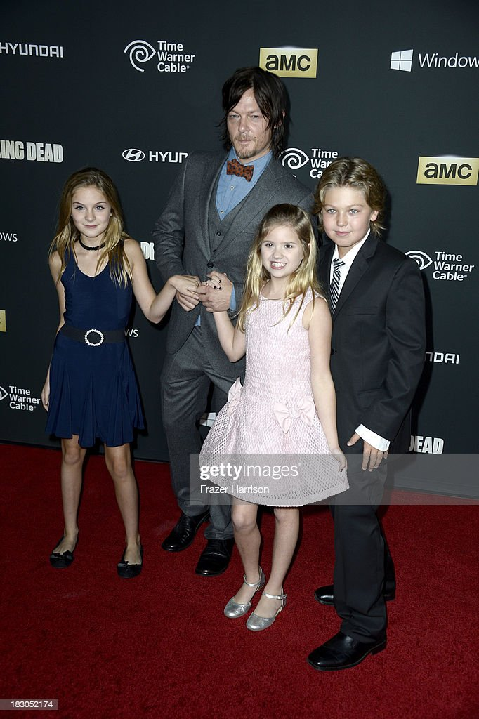 Actors <a gi-track='captionPersonalityLinkClicked' href=/galleries/search?phrase=Norman+Reedus&family=editorial&specificpeople=747258 ng-click='$event.stopPropagation()'>Norman Reedus</a>, Brighton Sharbino and Kyla Kenedy arrive at the premiere of AMC's 'The Walking Dead' 4th season at Universal CityWalk on October 3, 2013 in Universal City, California.