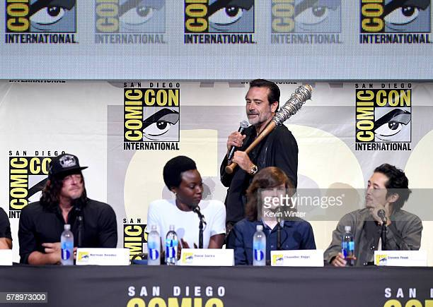 Actors Norman Reedus Danai Gurira Jeffrey Dean Morgan Chandler Riggs and Steven Yeun attend AMC's 'The Walking Dead' panel during ComicCon...