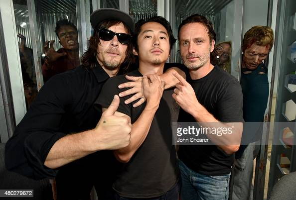 Actors Norman Reedus Steven Yeun and Andrew Lincoln attend AMC's 'The Walking Dead' at ComicCon 2015 on July 10 2015 in San Diego California