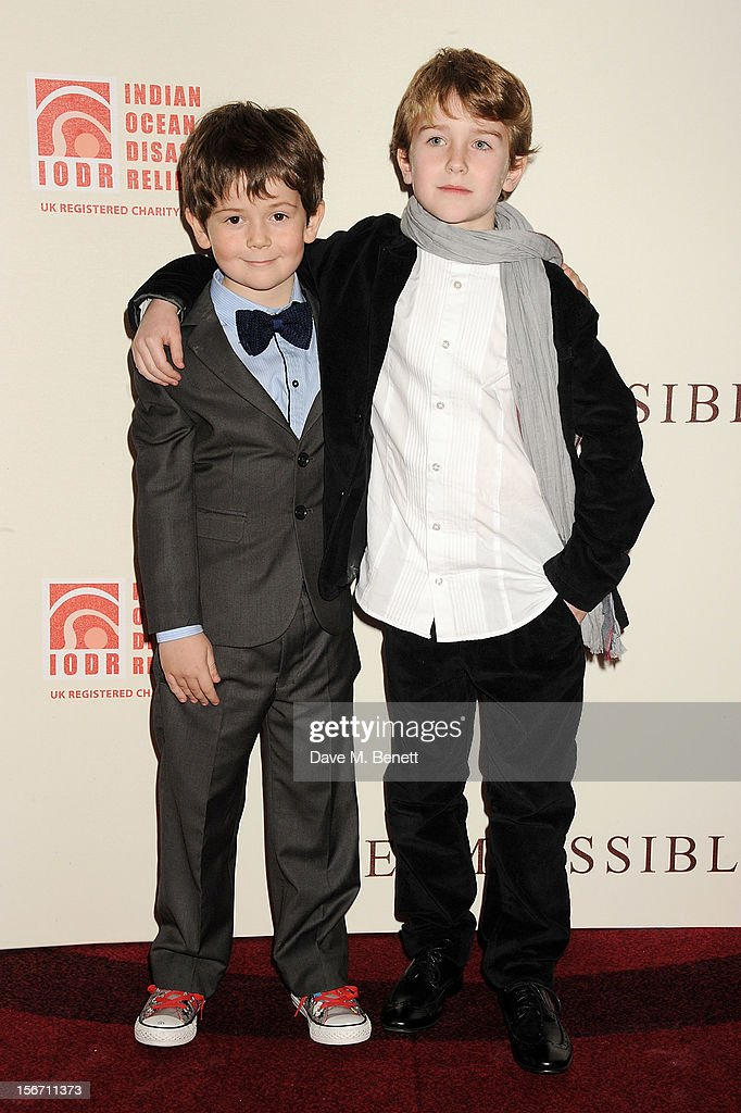 Actors Oaklee Pendergast (L) and Samuel Joslin attend the UK charity premiere of 'The Impossible' at BFI IMAX on November 19, 2012 in London, England.