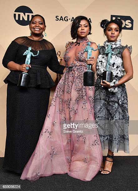 Actors Octavia Spencer Taraji P Henson and Janelle Monae winners of the Outstanding Cast in a Motion Picture award for 'Hidden Figures' poses in the...
