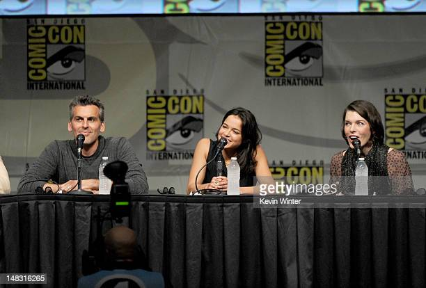 Actors Oded Fehr Michelle Rodriguez and Milla Jovovich speak at the Screen Gems' 'Resident Evil Retribution' panel during ComicCon International 2012...